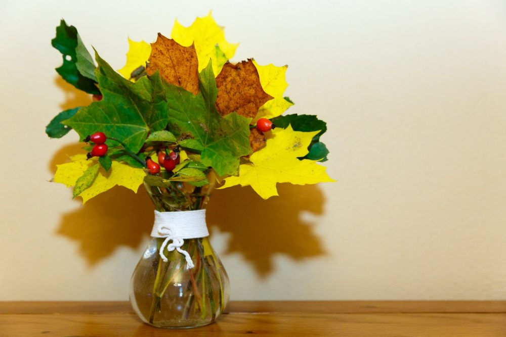 fall leaves in vase hearth decorations