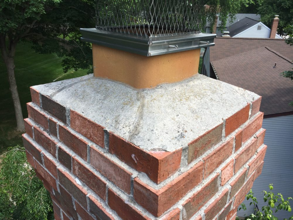 damaged concrete chimney crown