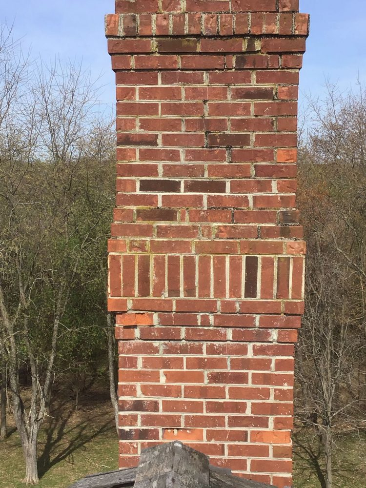 damaged chimney brick repaired